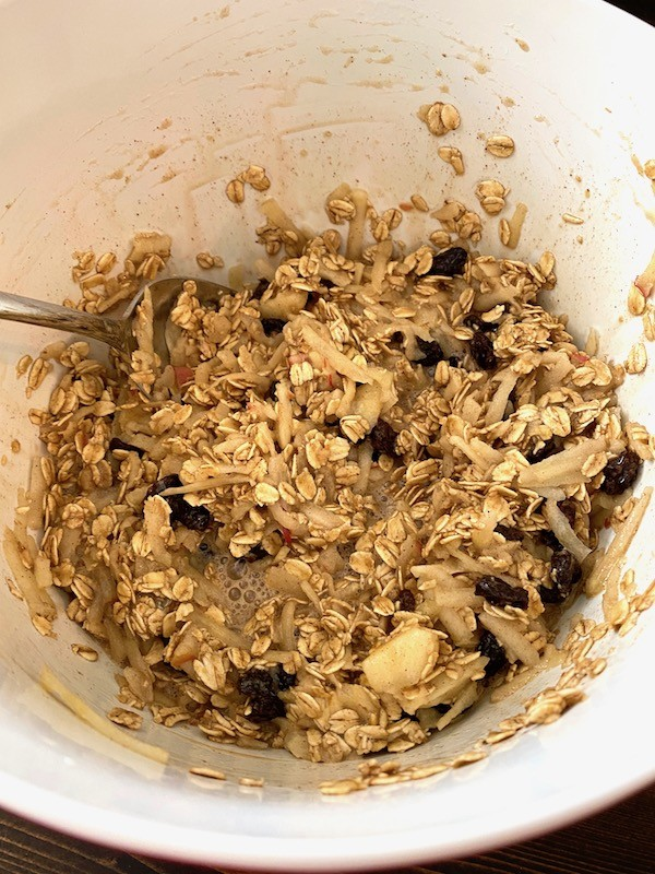 Raisins and shredded apple added to the rest of the ingredients