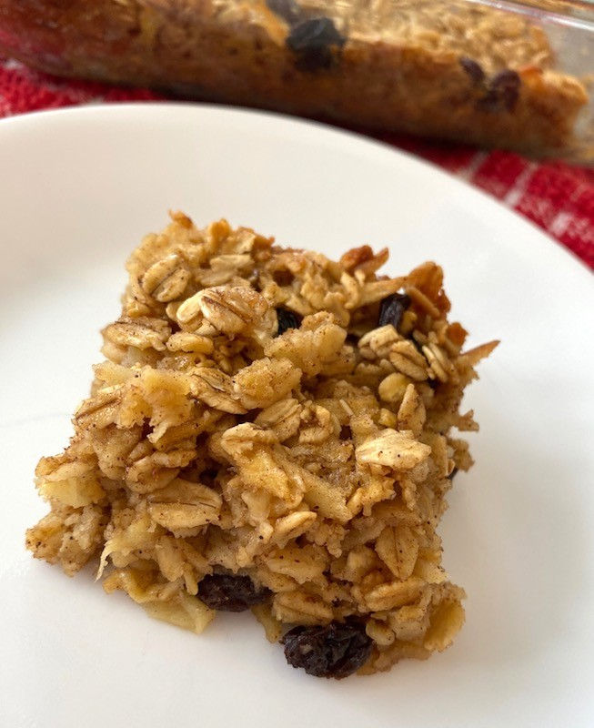 Apple raisin oat bar on a white plate