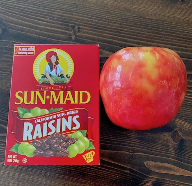Raisins and an apple