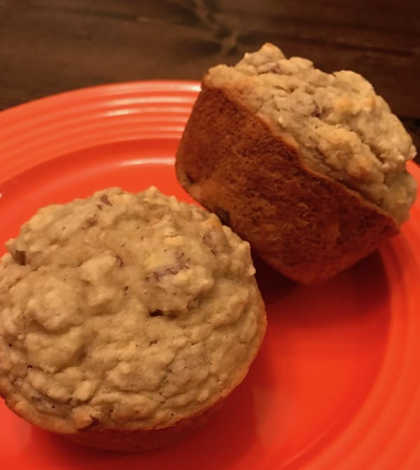 2 banana nut muffins on a plate