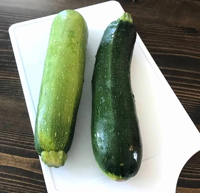 2 large zucchinis on a cutting board