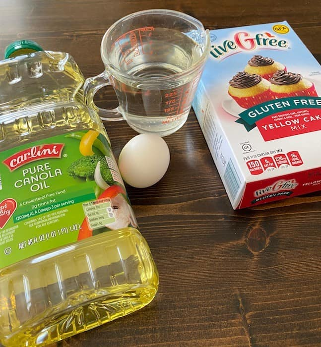 Cake mix, cup of water, egg, and cooking oil
