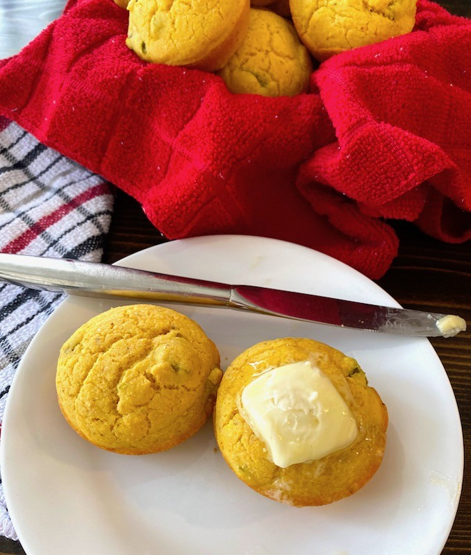 Buttered corn muffins on a plate