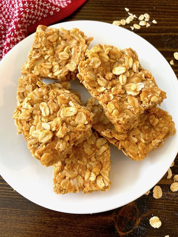 Oatmeal peanut butter bars stacked on a plate