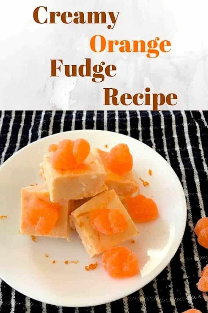 Pieces of creamy orange fudge on a plate