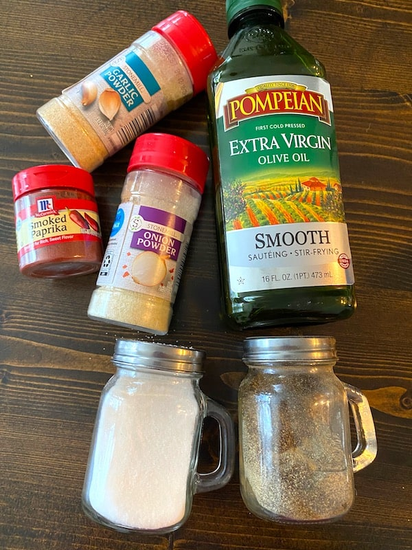 Garlic powder, smoked paprika, onion powder, olive oil, salt, and pepper