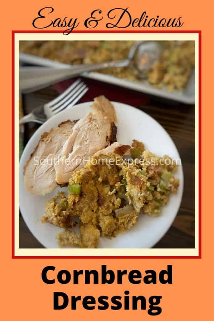 Cornbread dressing on a plate beside chicken