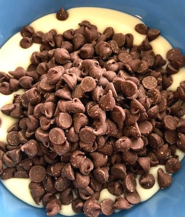 Chocolate chips in a bowl of sweetened condensed milk