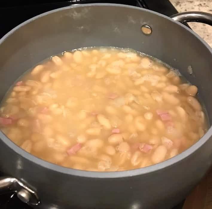 Pot of homemade bean soup cooking