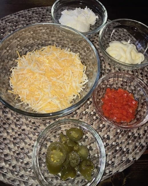 Shredded cheese, whipped cream cheese, mayonnaise, chopped pimentos, and jalapenos for southern style pimento cheese