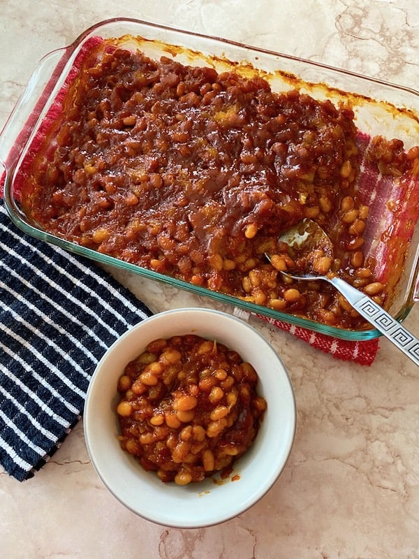 Pan and bowl of smoky pineapple baked beans