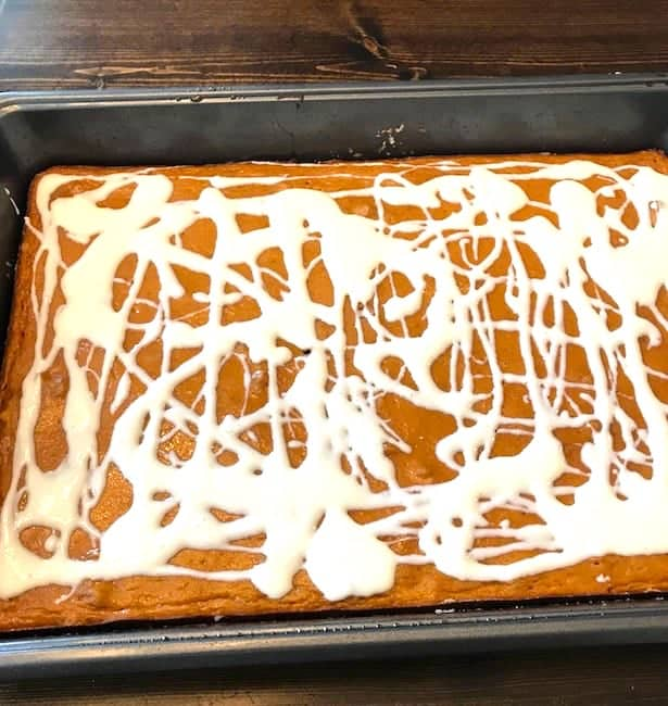Cream cheese frosting drizzled the cooked pumpkin bas