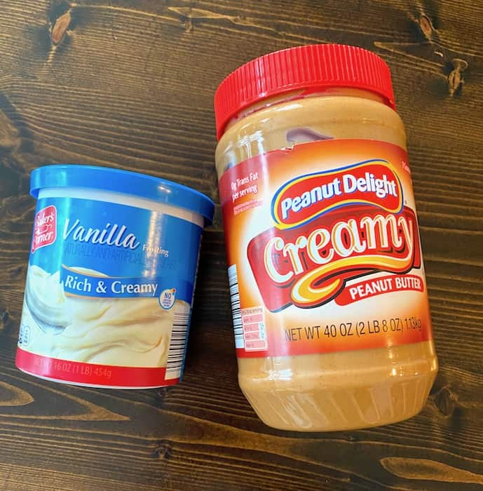 Can of vanilla frosting and jar of peanut butter