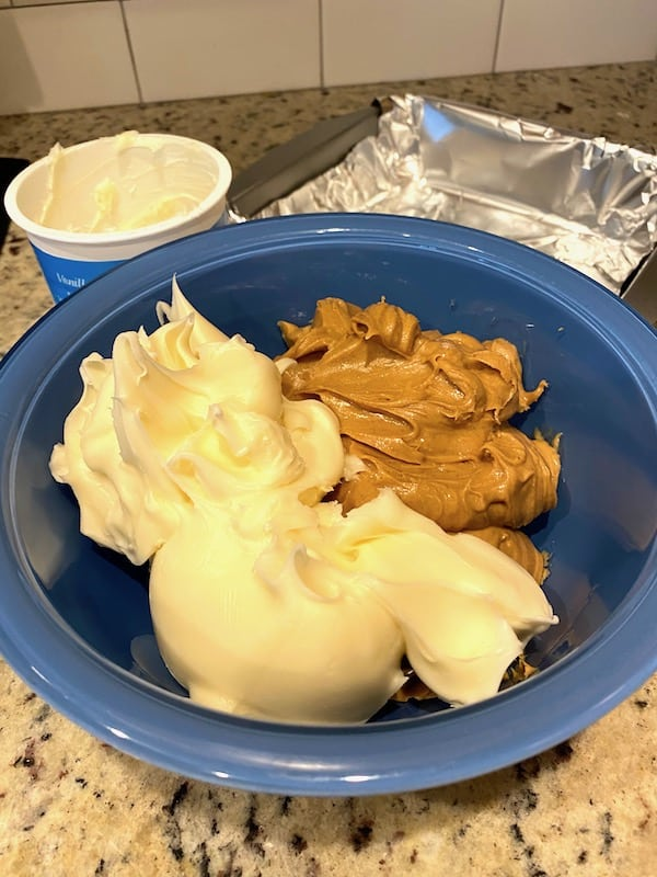 Frosting and peanut butter in a bowl