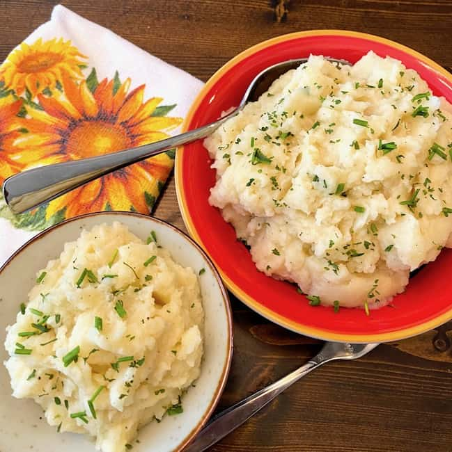 2 bowls of buttermilk garlic mashed potatoes with chives