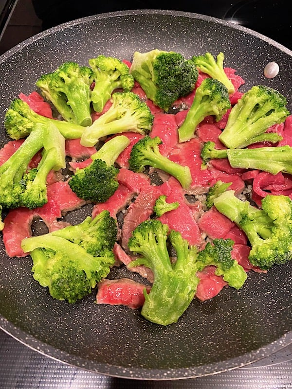 Garlic, beef, and broccoli in a pan