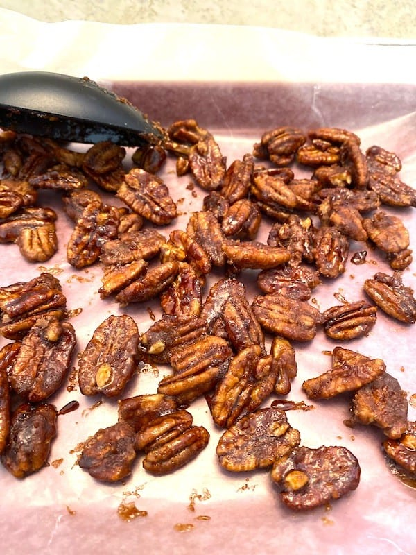 Sugar coated pecans on wax paper