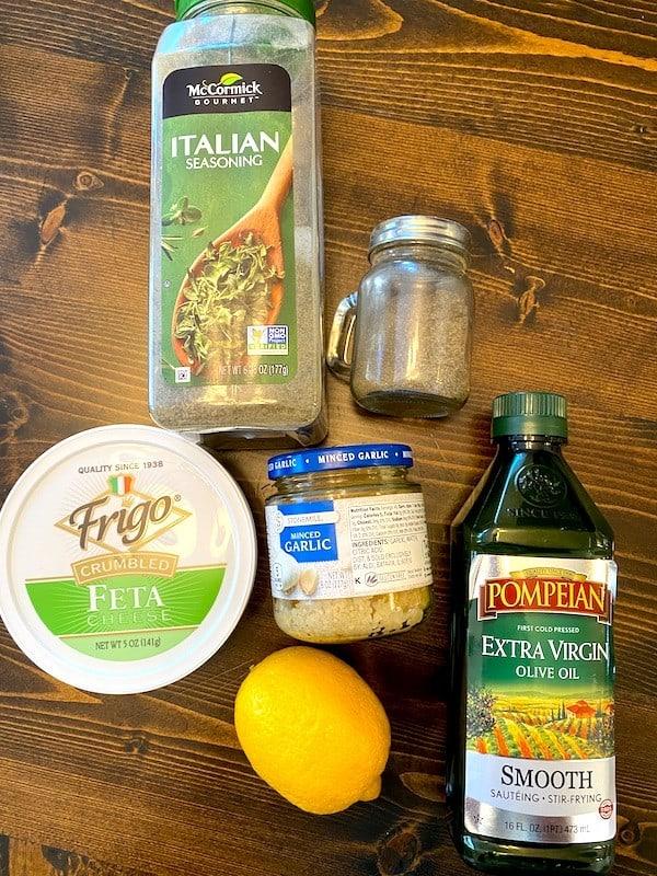 Italian seasoning, black pepper, feta cheese, minced garlic, olive oil, and lemon