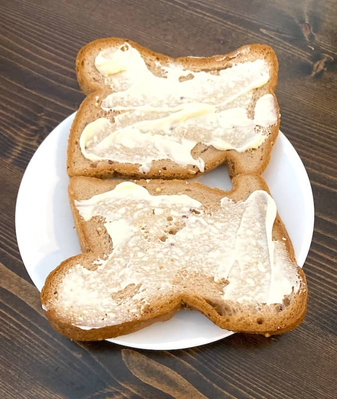 mayonnaise slathered on 2 pieces of bread