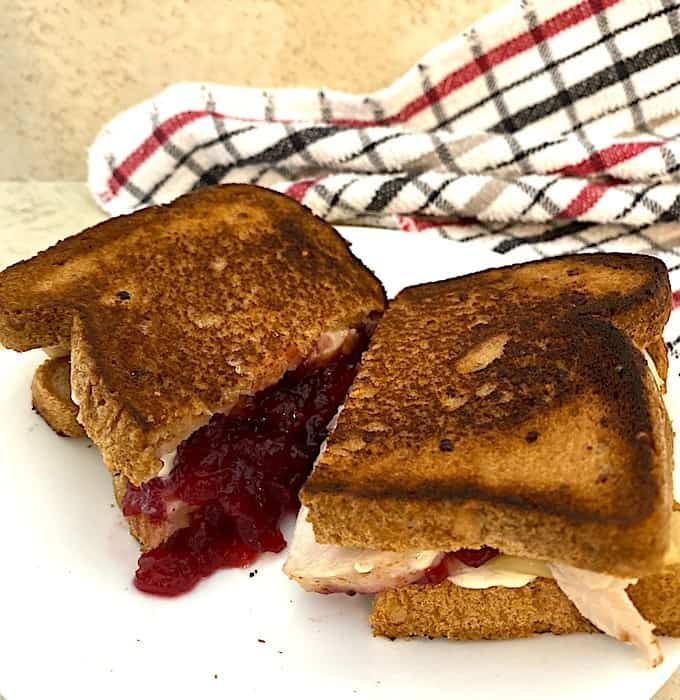 cranberry sauce oozing out of the sandwich