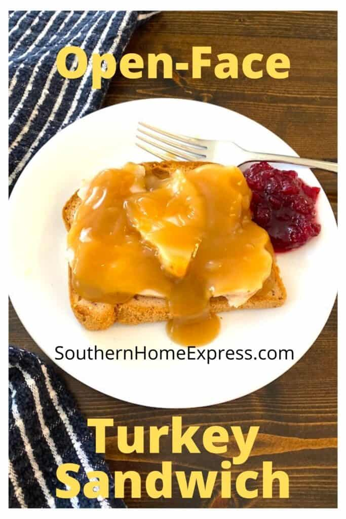 plate of open-face turkey sandwich with a side of cranberry sauce