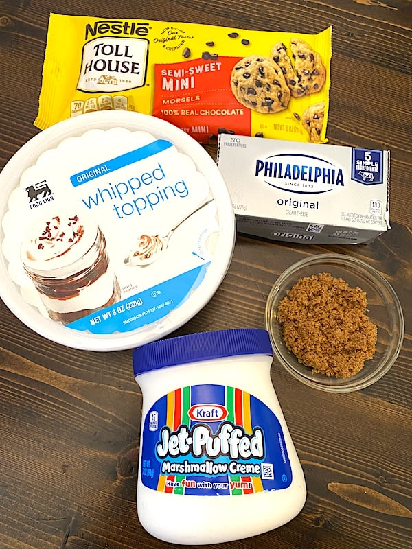 ingredients for chocolate chip fluff dip - whipped topping, cream cheese, mini chocolate chips, brown sugar, and marshmallow fluff
