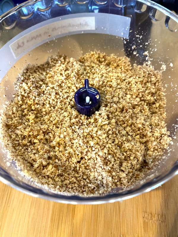 ground pecans and coconut in food processor