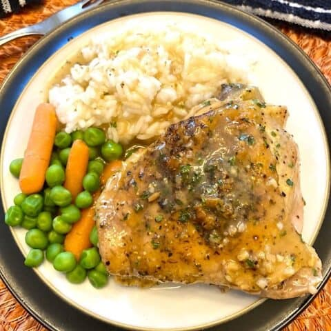 lemon chicken on a plate with rice and vegetables