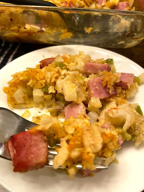 fork full of ham and potato casserole
