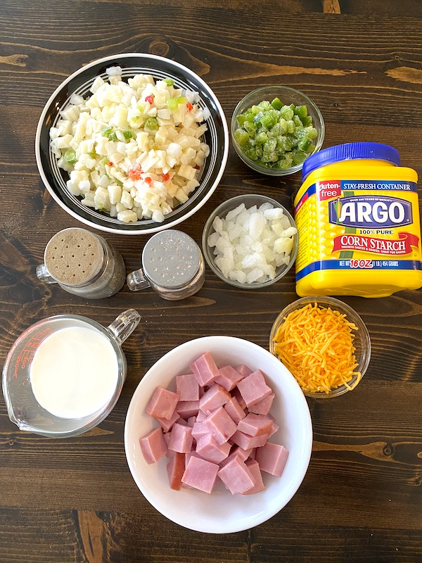 potatoes, diced green peppers, diced onions, corn starch, cheese, diced ham, milk, salt, and pepper