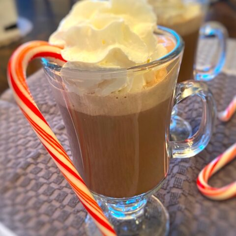 mug of hot chocolate with candy cane