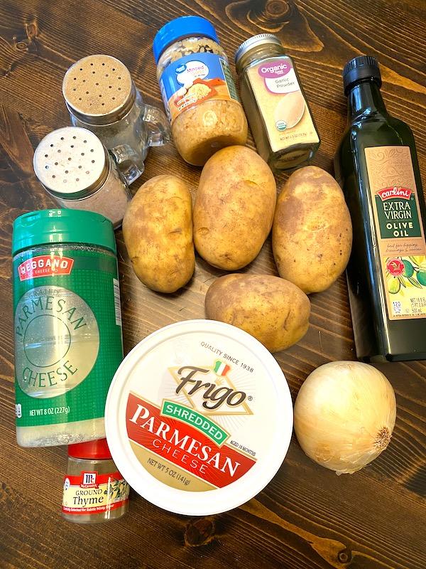 ingredients for parmesan potato bake: grated parmesan, shredded parmesan, potatoes, salt, pepper, minced garlic, garlic powder, olive oil, and onion