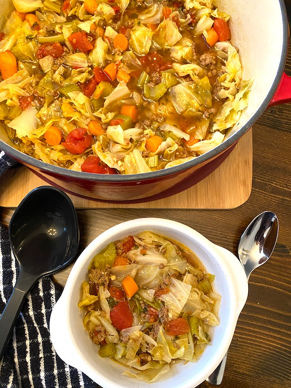 pot and bowl of beef and cabbage soup