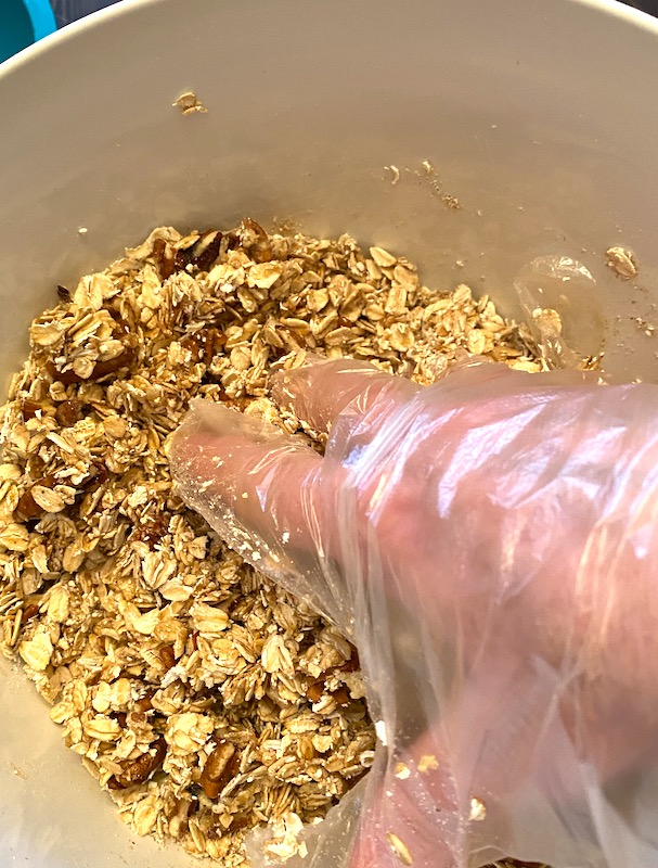 mixing the granola by hand