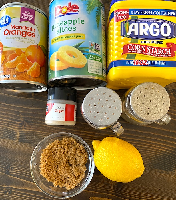 can of mandarin oranges, pineapple slices, ground ginger, salt, pepper, brown sugar, and lemon
