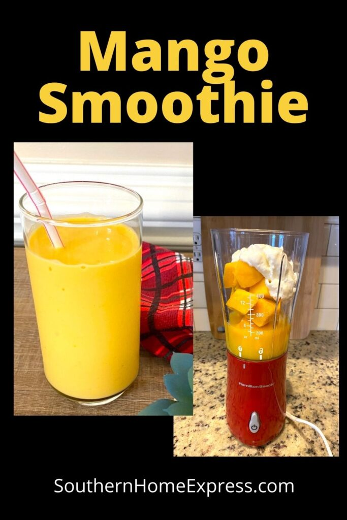 smoothie in a glass next to a blender with mango smoothie ingredients