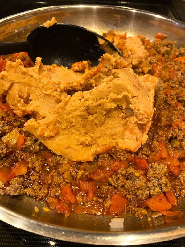 refried beans added to mixture