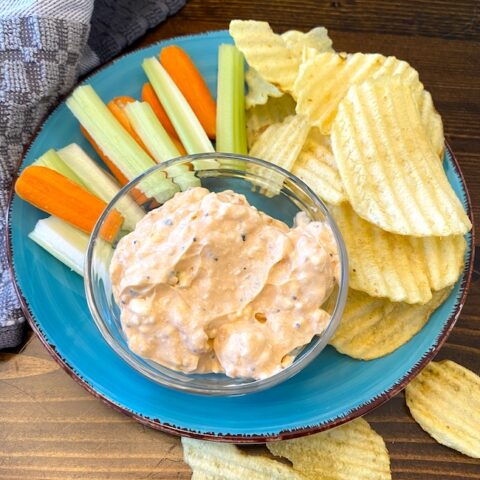 bowl of everything bagel dip with carrots, celery, and potato chips