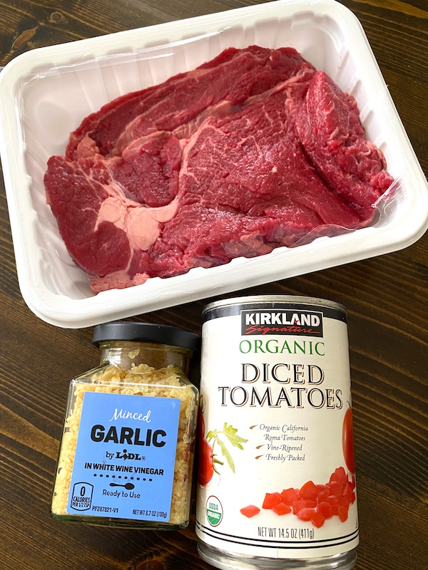 uncooked chuck roast, minced garlic, and diced tomatoes