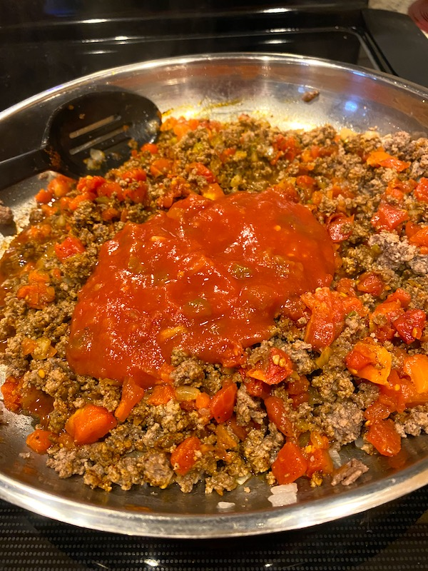 ground beef, salsa, and taco seasoning in a pan