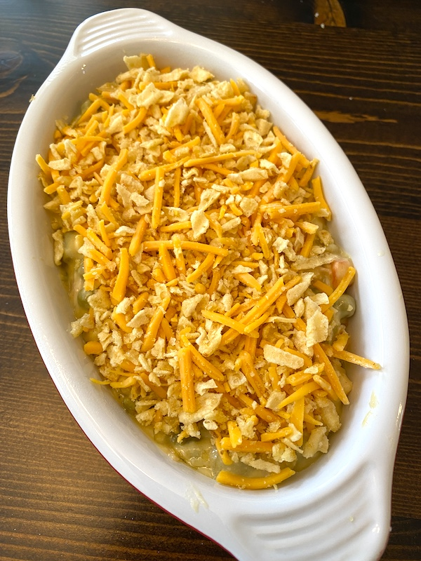 crushed chips and shredded cheese topping over chicken pot pie in an au gratin dish