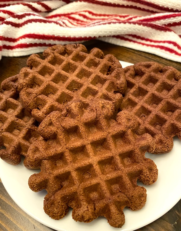 4 brownie waffles on a plate.