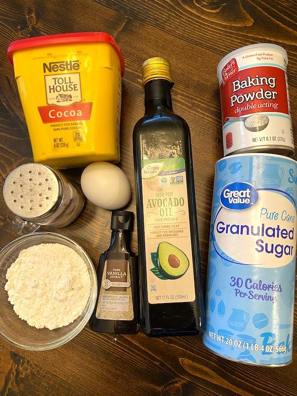 cocoa powder, cooking oil, baking powder, granulated sugar, egg, salt, flour, and vanilla extract