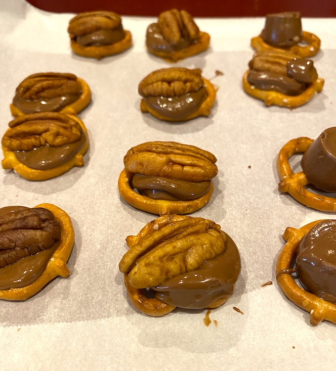 pecans pressed into semi-melted Rolos