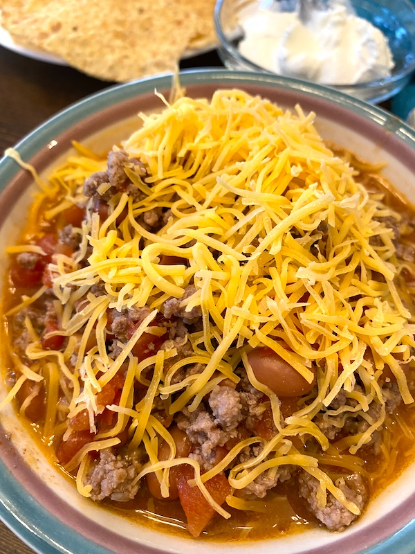 chili with cheese and a side of sour cream