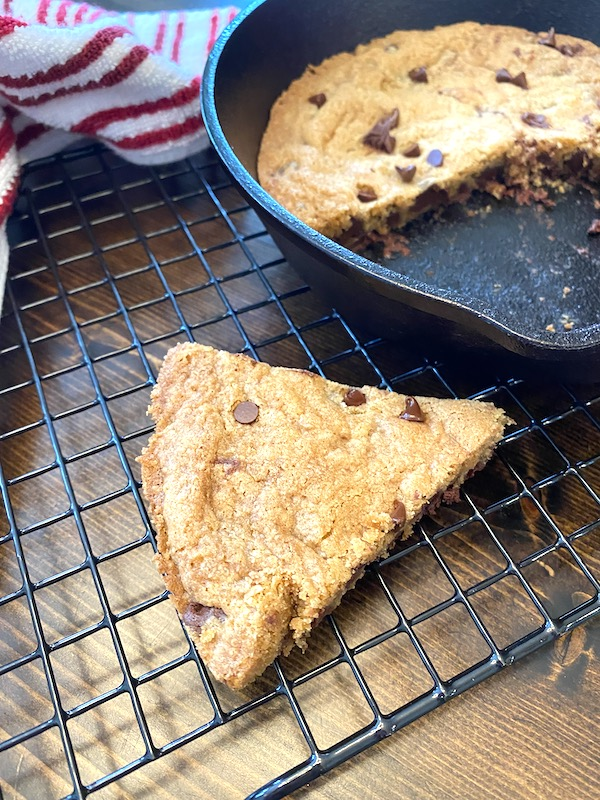 slice of skillet cookie next to the skillet.