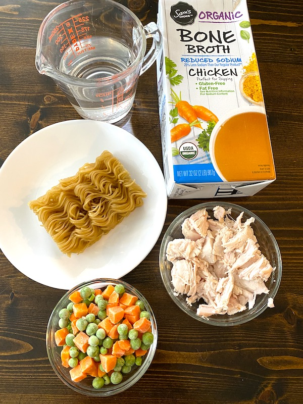 water, chicken broth, block of ramen noodles, chopped chicken, and vegetables