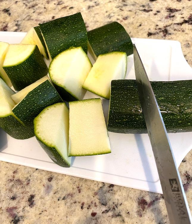 cutting zucchini into bite-size pieces