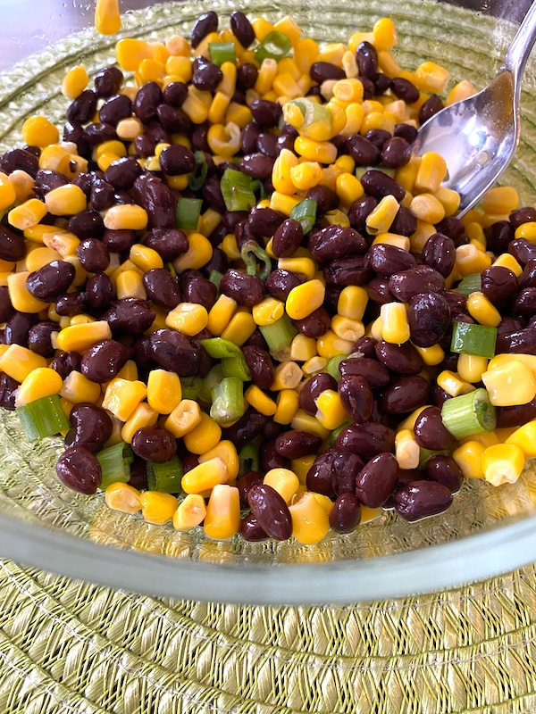 corn added to the black beans and green onions