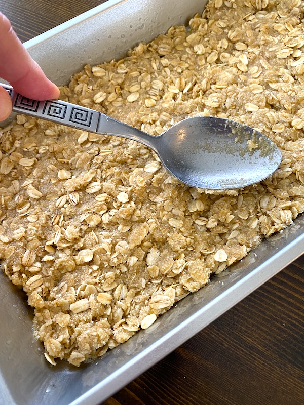 oatmeal mixture pressed into the bottom of the pan